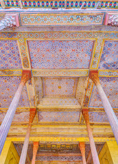 The wooden ceiling of entrance gallery of Chehel Sotoun Palace in Isfahan, Iran