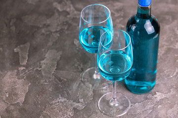 Two glasses and bottle of trendy blue wine. Spanish chardonnay