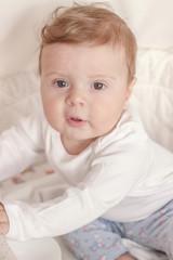 Portrait of joyfil, happiness baby in the bedroom, blurred background