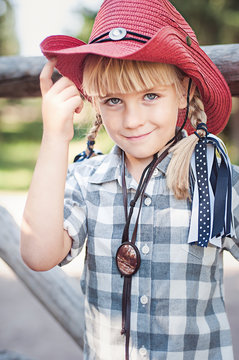 little smile cowboy girl on the ranch.