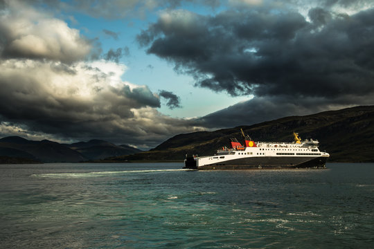 Large Ferry Boat At Loch Broom Leaves The Harbor Of Ullapool In Scotland