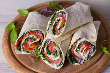 Salmon and cream cheese wraps. Wraps with salmon. Homemade tasty burrito
