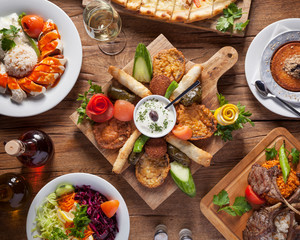 Arabic food, top down shot - Delicious turkish meals, beautifully arranged oriental dishes on a wooden table