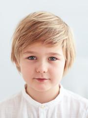 shoulder portrait of cute, nine years old kid, boy for id card