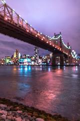 Blurred View on Queensboro bridge and Midtown Manhattan