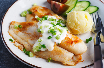 Fried Basa Fillet with sauce, mashed potato and fresh vegetables