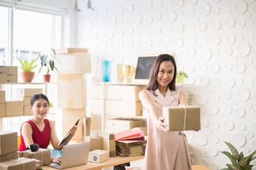 Asian owner woman holding box in home office,Online marketing packing delivery box