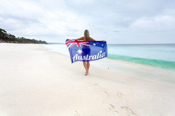 Female on beach with Australian flag Australia Pride