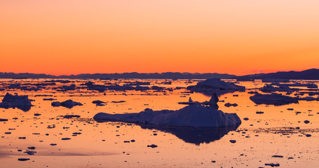 Global Warming and Climate Change - Icebergs from melting glacier on Greenland
