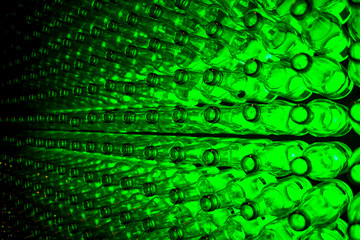 Green glass bottles wall stacked together installation with light