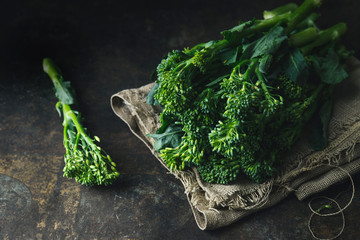 Baby broccoli on rustic background