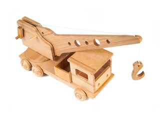 Photo of a wooden crane truck made of beech on a white isolated background