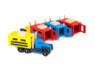 Photo of a wooden truck with a beech trailer in different colors   on a white isolated background