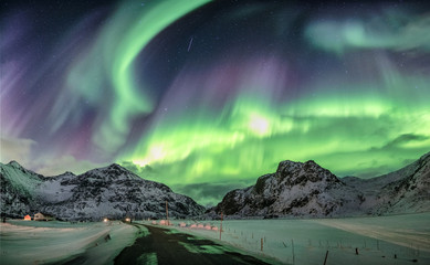 Aurora borealis, Northern lights over snow mountain range Wall mural