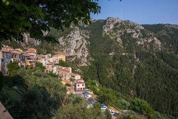 View of ot hte hilltop village of Peille in southeastern France and the surrounding mountains on the path leading into the village