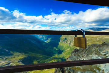 Padlock on rail and mountains view, Norway