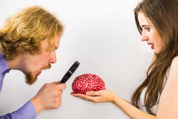 Man and woman discovering brain