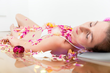 Close-up of a woman relaxing in spa
