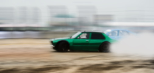 Car drifting, Blurred of image diffusion race drift car with lots of smoke from burning tires on speed track
