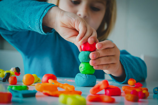 Child playing with clay molding shapes, kids crafts