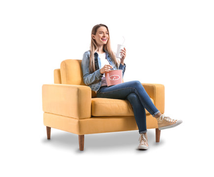 Young woman with popcorn watching movie on white background