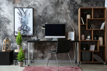 Beautiful interior of modern room with comfortable workplace