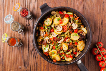 Fried pan vegetables, with mushrooms and dried tomatoes. Seasoned with a mix of herbs.