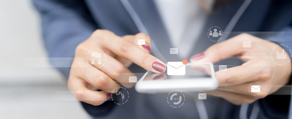 close up businesswoman holding smartphone and checking email online on web with virtual interface technology concept