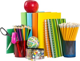 School supplies with an apple on top - isolated image