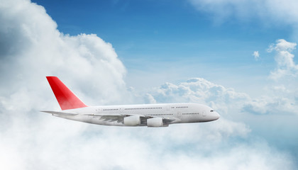 Huge two-storey passengers commercial airplane flying above dramatic clouds.