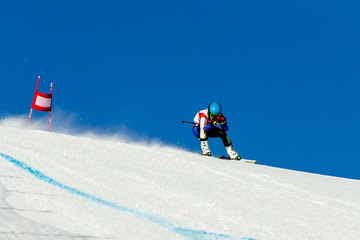 man racer in downhill skiing competition alpine skiing