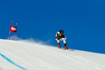 racer riding in downhill skiing competition alpine skiing