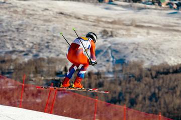 man racer jump in downhill slalom alpine skiing