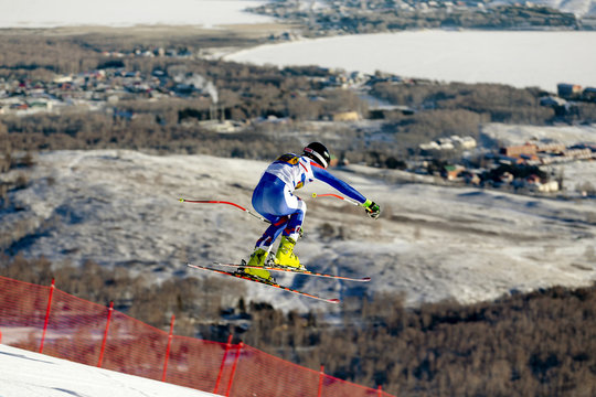 racer downhill slalom jump in alpine skiing competitive