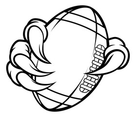 Eagle, bird or monster claw or talons holding an American football ball. Sports graphic.