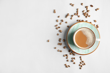 Cup of hot coffee on white background
