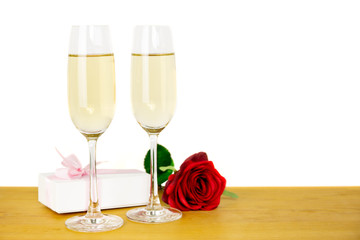 Glasses of champagne with rose flower and Valentines day gift box Isolated.