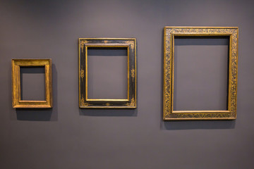 Set of vintage blank picture frames on grey wall