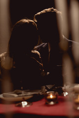 silhouette of couple during romantic date in restaurant