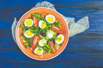 Fresh healthy delicious salad in orange plate