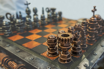 Chess pieces on chess board. Strategy board game. Toned image with space for text and selective focus on rook. Abstract background.