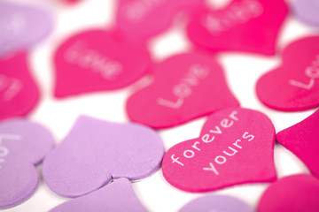 Pink hearts with white background. Valentines card
