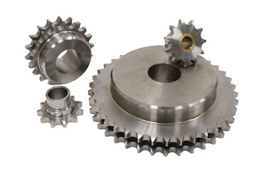 Isolated engine metallic gear wheel on a white background