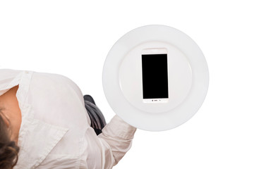 Mobile phone served on empty serving plate. Top view of a waitress in a white blouse on the white background. Concept. Isolated