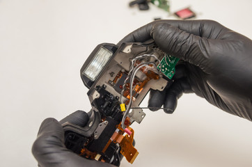 Disassembled camera body in the hands of the master