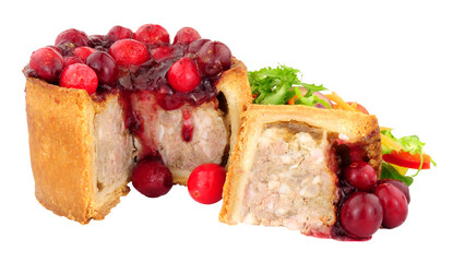 Foto op Plexiglas Buffet, Bar Pork pie topped with cranberries with fresh salad isolated on a white background