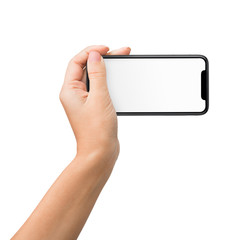 Hand holding mobile phone in horizontal position for mockup