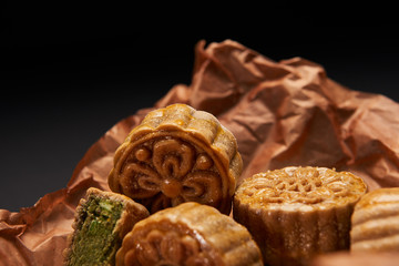 close up of traditional chinese mooncakes isolated on black