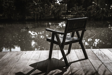 Chairs placed in the waterfront along the stream in a quiet atmosphere