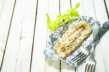 Baked fish fillet with spices and celery.